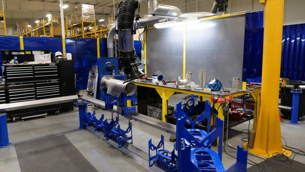 The new stainless steel welding and fabrication booth in the Technology Center specializes in coping and assembly of Industrial Water and Porta Kleen piping systems utilizing a specialty assembly jig.